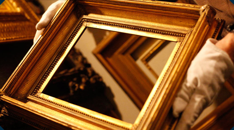 Close-up of a gilded antique period frame