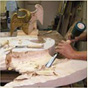 An expert begins intricate chiselling on the eagle