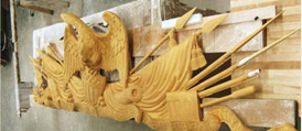Detail of the eagle atop pikes and muskets at the top of the frame