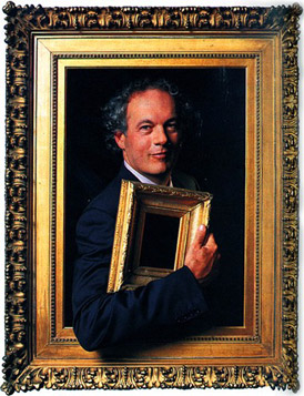 Eli Wilner within an antique period frame holding a smaller frame in his hand