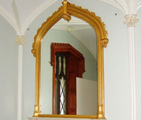 Carved replicas of a pair of Gothic-style carved and gilded overmantel mirrors for the reading room at the historical site Lyndhurst