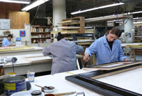 Experts work in the frame restoration studio